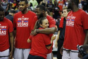 San Antonio Spurs coach Becky Hammon hugs Jonathan Simmons after they defeated Phoenix Suns in an NBA summer league championship basketball game Monday, July 20, 2015, in Las Vegas. (AP Photo/John Locher)