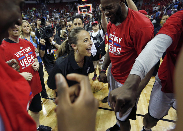 San Antonio Spurs coach Becky Hammon celebrates with her team after they defeated the Phoenix Suns in an NBA summer league championship basketball game, Monday, July 20, 2015, in Las Vegas. (AP Photo/John Locher)
