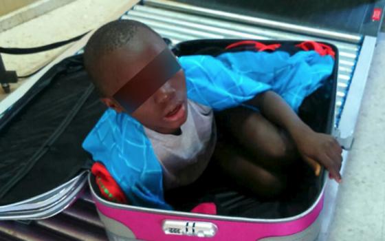 Boy-in-Suitcase-1