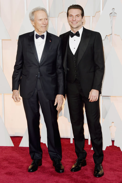 Director Clint Eastwood (L) and actor Bradley Cooper