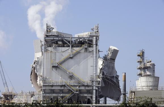 Refinery units are heavily damaged after an explosion at the Exxon-Mobil refinery in Torrance