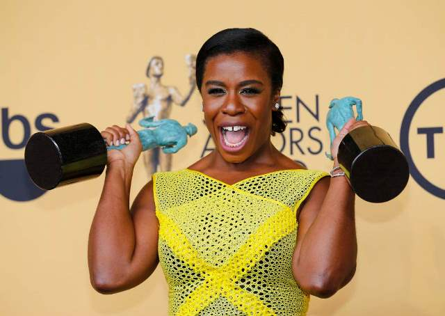"""Uzo Aduba of the Netflix series """"Orange is the New Black"""" poses backstage with her awards for Outstanding Performance by an Ensemble in a Comedy Series and Outstanding Performance by a Female Actor in a Comedy Series at the 21st annual Screen Actors Guild Awards in Los Angeles, California January 25, 2015.  REUTERS/Mike Blake (UNITED STATES - Tags: ENTERTAINMENT) (SAGAWARDS-BACKSTAGE) - RTR4MVHA"""