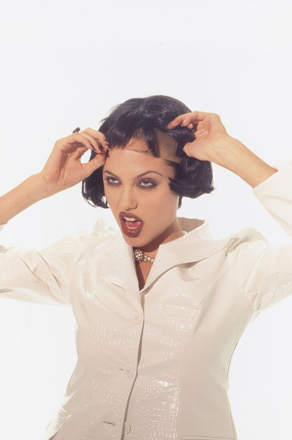 EXCLUSIVE: **PREMIUM RATES APPLY** A week after Angelina Jolie turned 40 these never-before-seen shots show the actress wigging out out in pictures taken TWENTY YEARS AGO when she was just half her age.