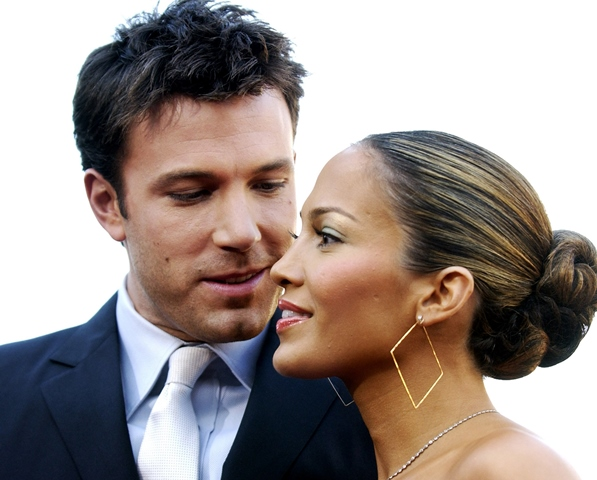 """** ADVANCE FOR WEEKEND, DEC 6-7--FILE ** Ben Affleck, left, and Jennifer Lopez are sown together in Los Angeles, in this Feb. 9, 2003 file photo. A&E's year-end countdown show """"Top 10 Hitched and Ditched,""""  airing Monday, Dec. 8, 2003 at 8 p.m. EST, claims the top spot to J-Lo & Ben. A weeks worth of """"Biography"""" hours count down to next week's """"Biography of the Year."""" (AP Photo/Chris Pizzello, File)"""