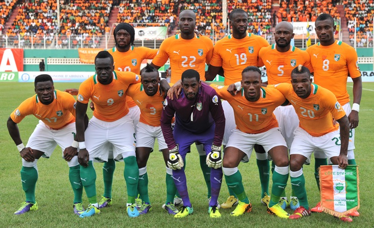 Ivory Coast's national football team players pose prior to the World Cup 2014 African zone qualifying football match between Ivory Coast and Senegal at the Felix Houphouet-Boigny stadium in Abidjan on october 12, 2013 . AFP PHOTO/ ISSOUF SANOGO        (Photo credit should read ISSOUF SANOGO/AFP/Getty Images)