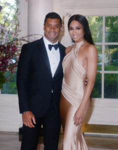 WASHINGTON, DC - APRIL 28: Russell Wilson from the Seattle Seahawks and Ciara Harris arrive for the State dinner in honor of Japanese Prime Minister Shinzo Abe And Akie Abe April 28, 2015 at the Booksellers area of the White House in Washington, DC. (Photo by Olivier Douliery/Getty Images) ORG XMIT: 551549785 ORIG FILE ID: 471455014
